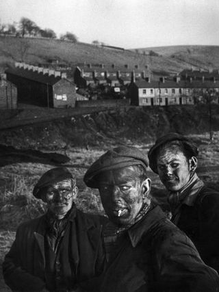 1224930~Three-Welsh-Coal-Miners-Just-Up-from-the-Pits-After-a-Day-s-Work-in-Coal-Mine-in-Wales-Posters